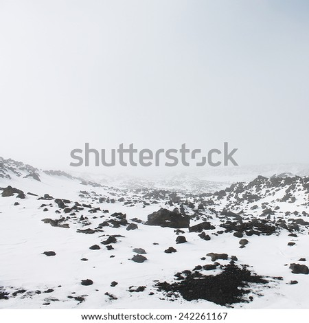 snow and frozen lava - stock photo