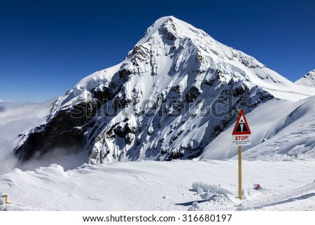 Snow and high  Mountain in Switzerland for your holiday trips. - stock photo