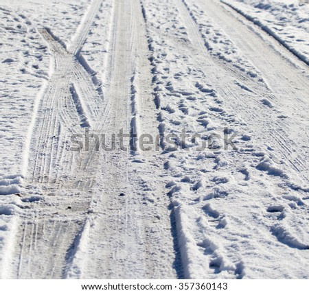 snow and ice on the road - stock photo