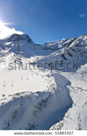 snow and ski lift in Switzerland Alps - stock photo