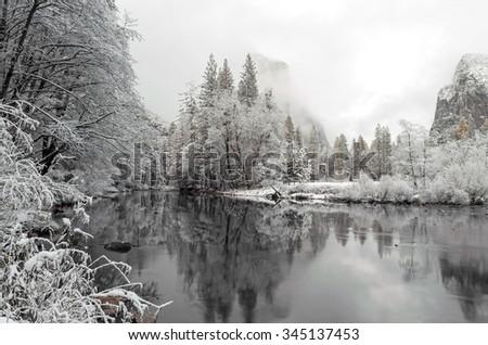 Snow at Yosemite National Park - Winter Wonderland Lake / River Reflection  - stock photo