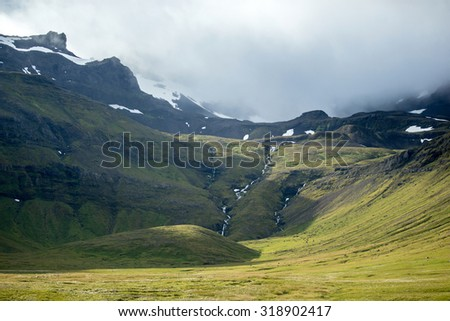 snow capped mountain and volcano in Iceland - stock photo