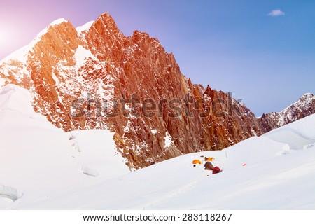 Snow capped mountains. base camp under the mount. Himalaya, Nepal. Trek around Annapurna mount - stock photo
