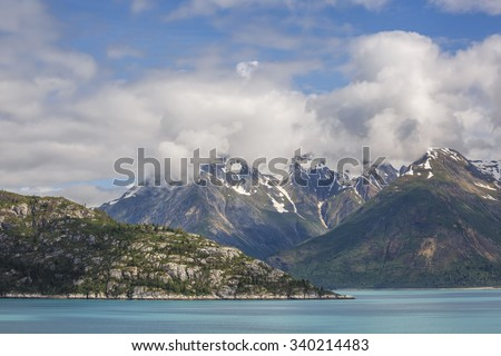 Snow capped mountains in the Glacier Bay National Park, Alaska - stock photo