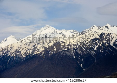 snow-capped peaks of majestic mountains. - stock photo
