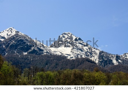 snow-capped peaks of majestic mountains. Sochi - stock photo