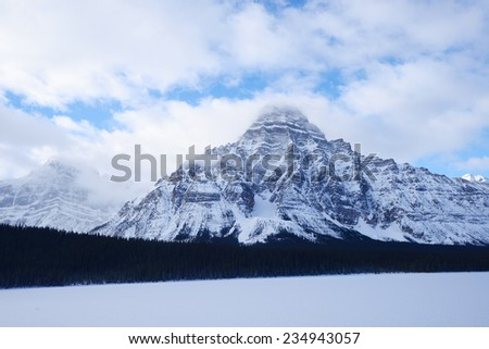 snow cover mountain peaks in national park, canada - stock photo
