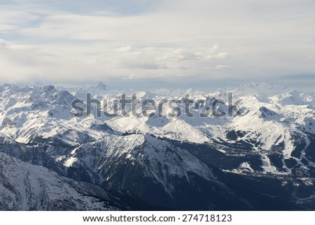 Snow covered alps mountains aerial view - stock photo