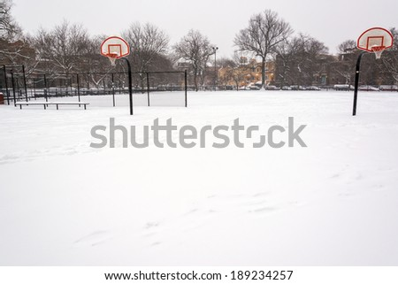 Snow covered basketball court in Wicker Park in Chicago - stock photo