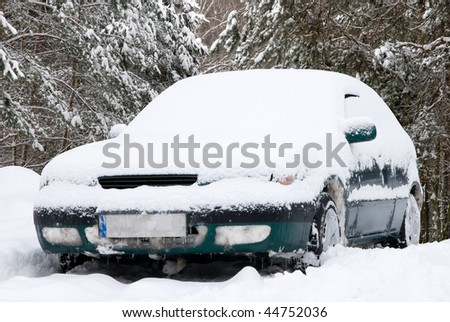 Snow covered car - stock photo