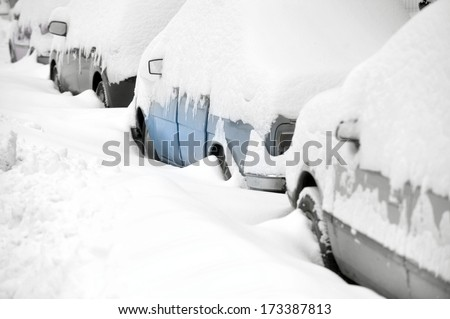 Snow covered cars after heavy snowfall - stock photo