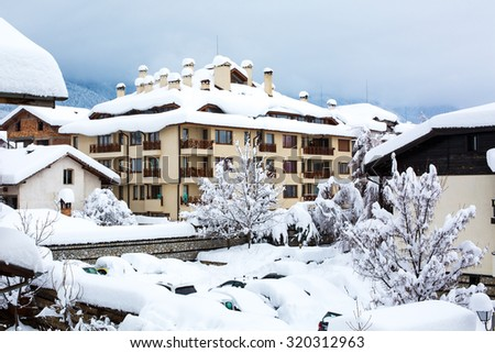 Snow covered chalets after the very hard snowfall - stock photo