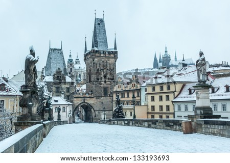 Snow Covered Charles Bridge in Prague - stock photo