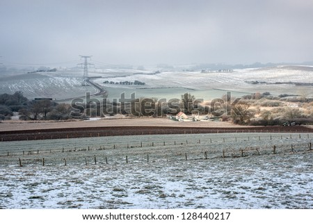 Snow covered farm in Lorraine, France - stock photo