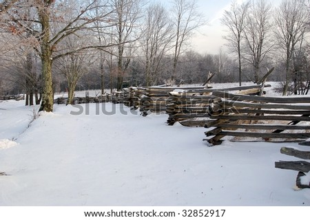 Snow Covered Fence - stock photo