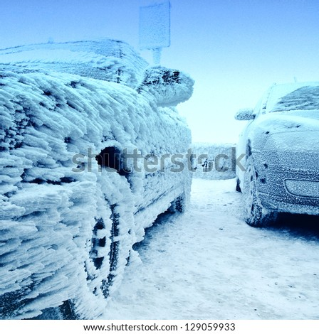 Snow covered frozen car at winter - stock photo