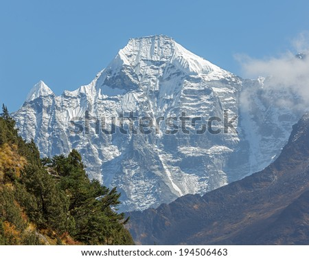 Snow-covered Himalayan peaks in the area Ama Dablam - Everest region, Nepal - stock photo