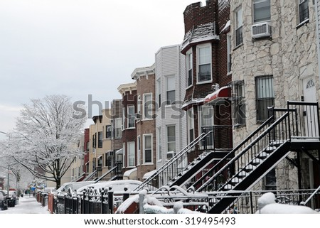 Snow covered houses photographed in borough park neighborhood of Brooklyn, NY on March 22, 2015. - stock photo