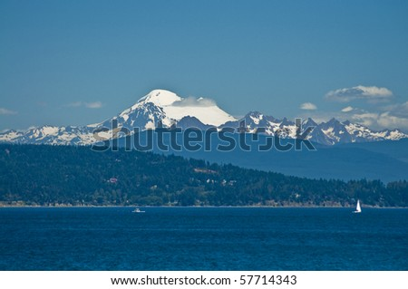 Snow covered Mount Baker from the Puget Sound in Washington state on a beautiful sunny day - stock photo