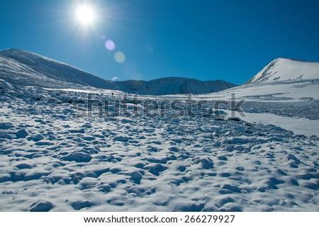 snow covered mountains with blue sky - stock photo