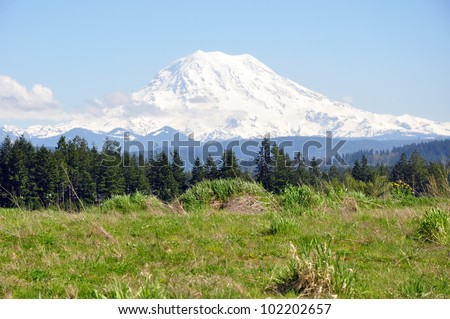 Snow covered Mt Rainier on a sunny Spring day - stock photo