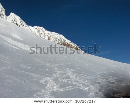 Snow covered peak of Mt. Hood in Oregon State with blue sky and rock formations. - stock photo