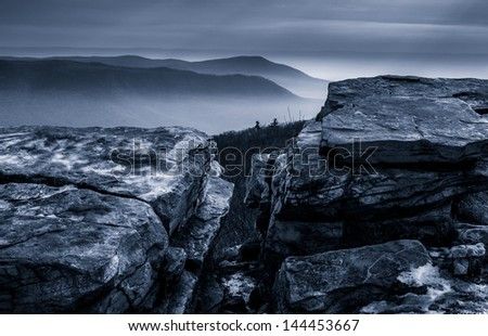 Snow covered rocks and a foggy winter view from Tower Road on Tuscarora Mountain near McConnellsburg, Pennsylvania - stock photo