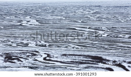 Snow covered sandur, starting to melt creating patterns, Southern Iceland - stock photo