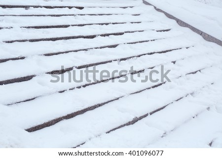 Snow-covered stairs, closeup - stock photo