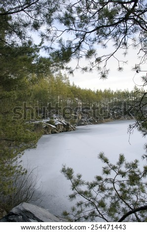 Snow covered stone quarry in the winter - stock photo