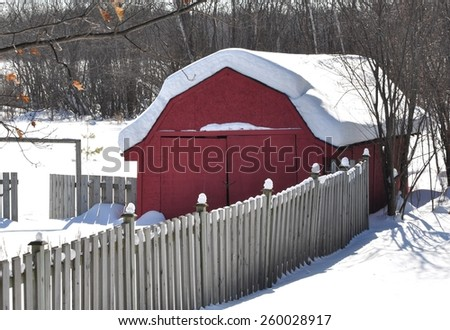 Snow covered storage area in the backyard - stock photo
