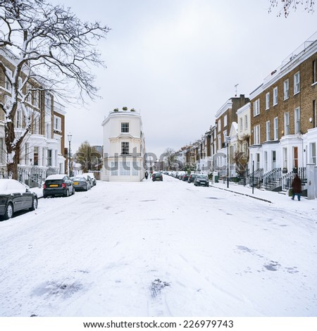 Snow covered street in Notting Hill, London - England. - stock photo