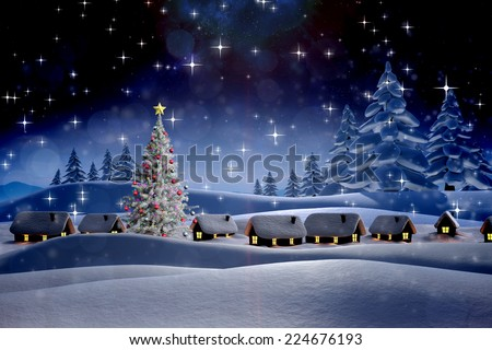 Snow covered village against snowy landscape with fir trees - stock photo