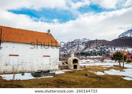 Snow-covered village in the mountains Montenegro. The village Vojkovici of the mountains of Montenegro - stock photo