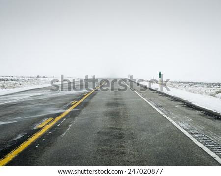 Snow covered winter roads Colorado - stock photo