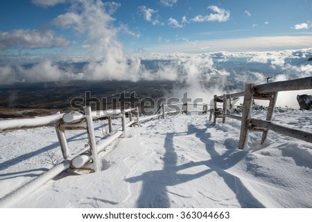 Snow covered winter trail. Blue sky and frozen view - stock photo