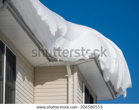 Snow drift on roof after two days of snowfalls - stock photo