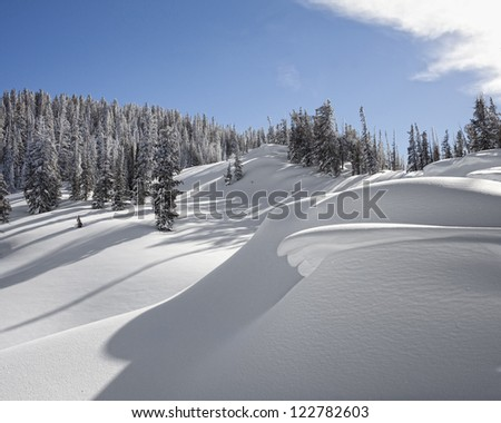 Snow drifts in the Tetons near Jackson Hole Mountain resort - stock photo