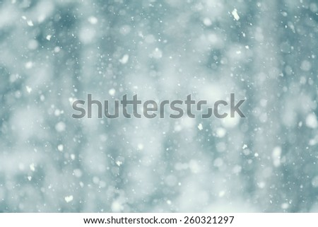 Snow falling abstract with a shallow depth of field for a dreamy look. - stock photo