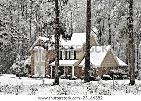 Snow falling on a beautiful executive home. - stock photo