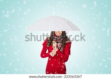 Snow falling on woman under umbrella - stock photo