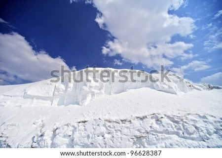 Snow Fields - Winter Background with Large Snowfields and Blue Cloudy Sky. Perfect Ski Conditions. - stock photo