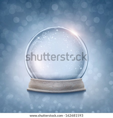 Snow globe on a blue background - stock photo