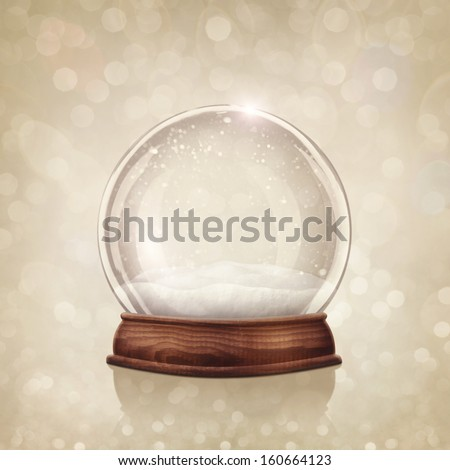 Snow globe on a golden background - stock photo