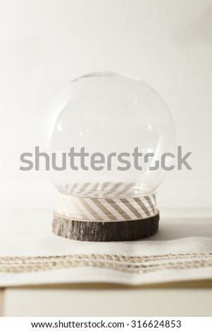 snow globe on cream background - stock photo