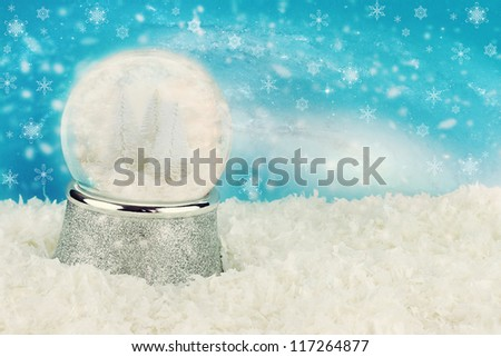 Snow globe with snow covered pine trees inside. Copy space available. - stock photo