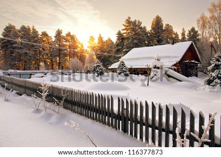 Snow house in winter dreamland at dawn in forest. ?old weather and a lot of snow on roof. - stock photo
