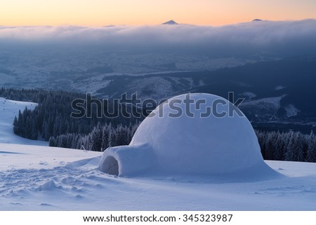 Snow igloo on a mountain hill. Winter landscape. Adventures in the winter campaign - stock photo