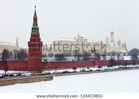 snow in Moscow - view of Grand Kremlin Palace and Kremlin wall and tower in winter - stock photo