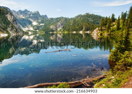 Snow lake in summer, Washington, mountains, water reflection, USA - stock photo